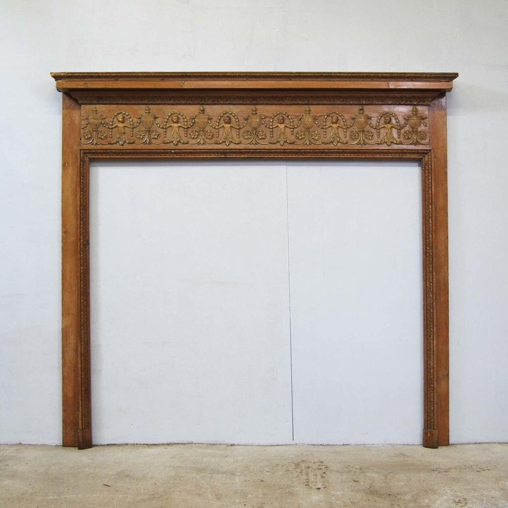 A George III carved pine and limewood fire surround-0