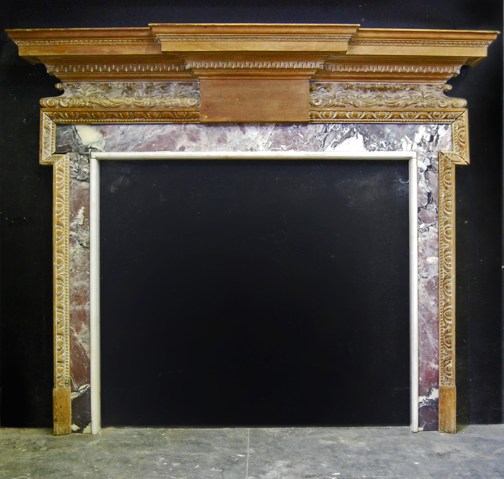 A George lll style carved pine fire surround with marble ingrounds-0