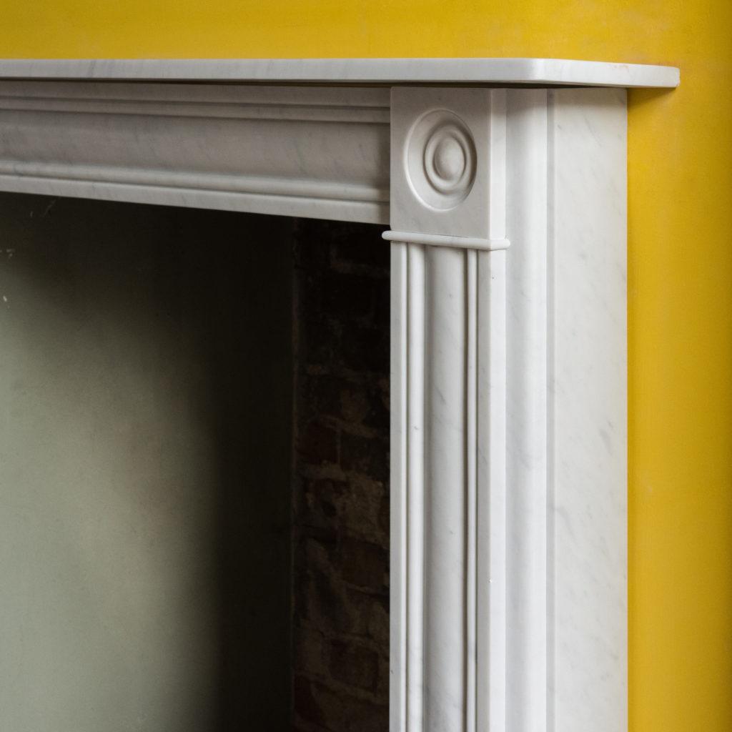 Regency style Carrara marble bullseye chimneypiece-99822
