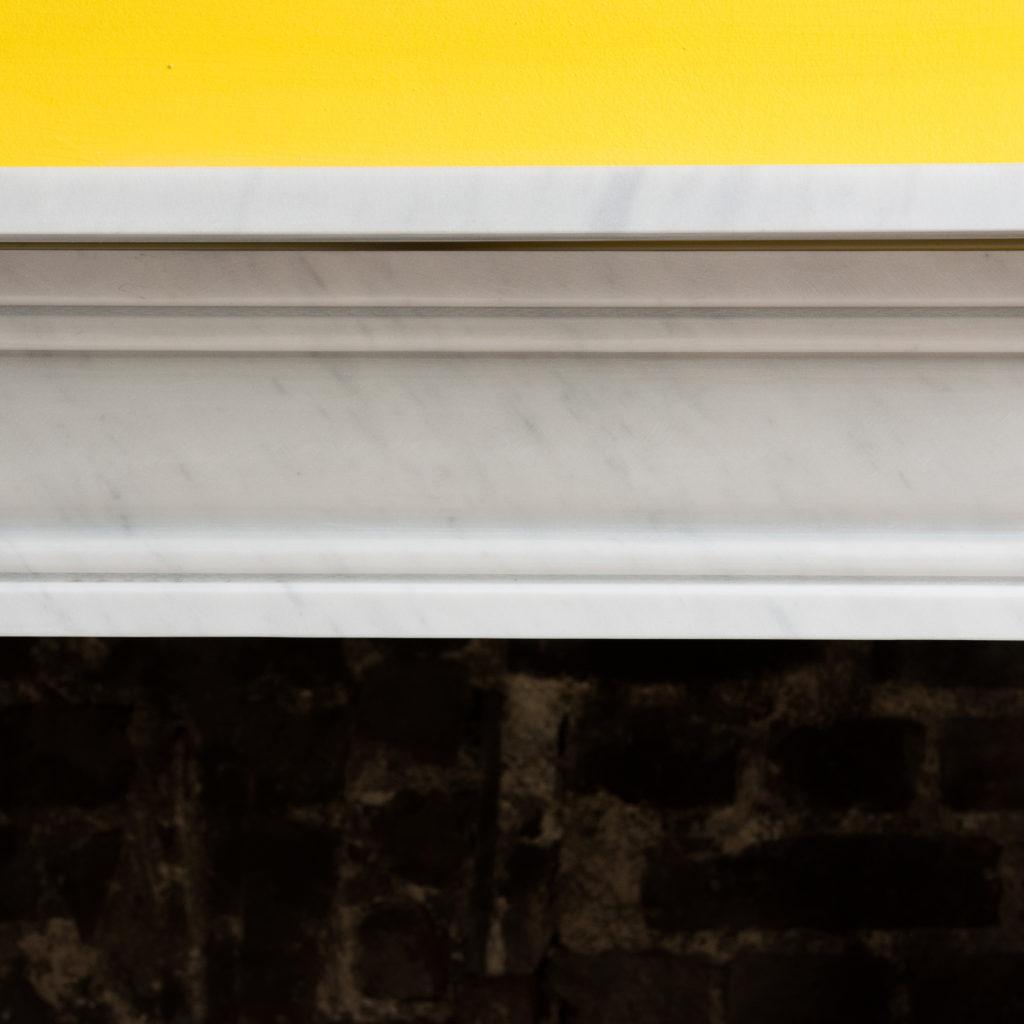 Regency style Carrara marble bullseye chimneypiece-99824