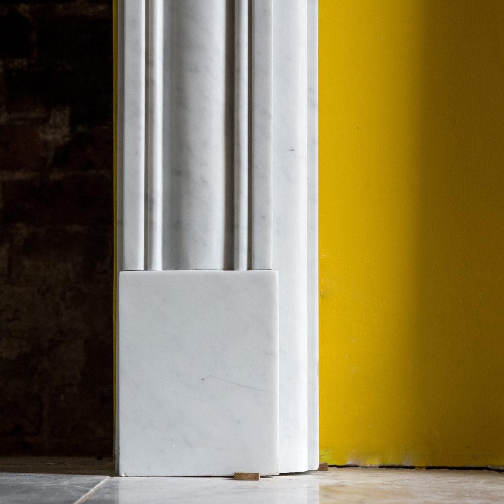 Regency style Carrara marble bullseye chimneypiece-99826