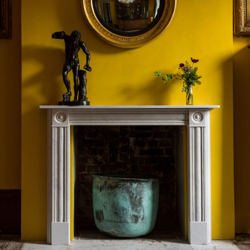 Regency style Carrara marble bullseye chimneypiece
