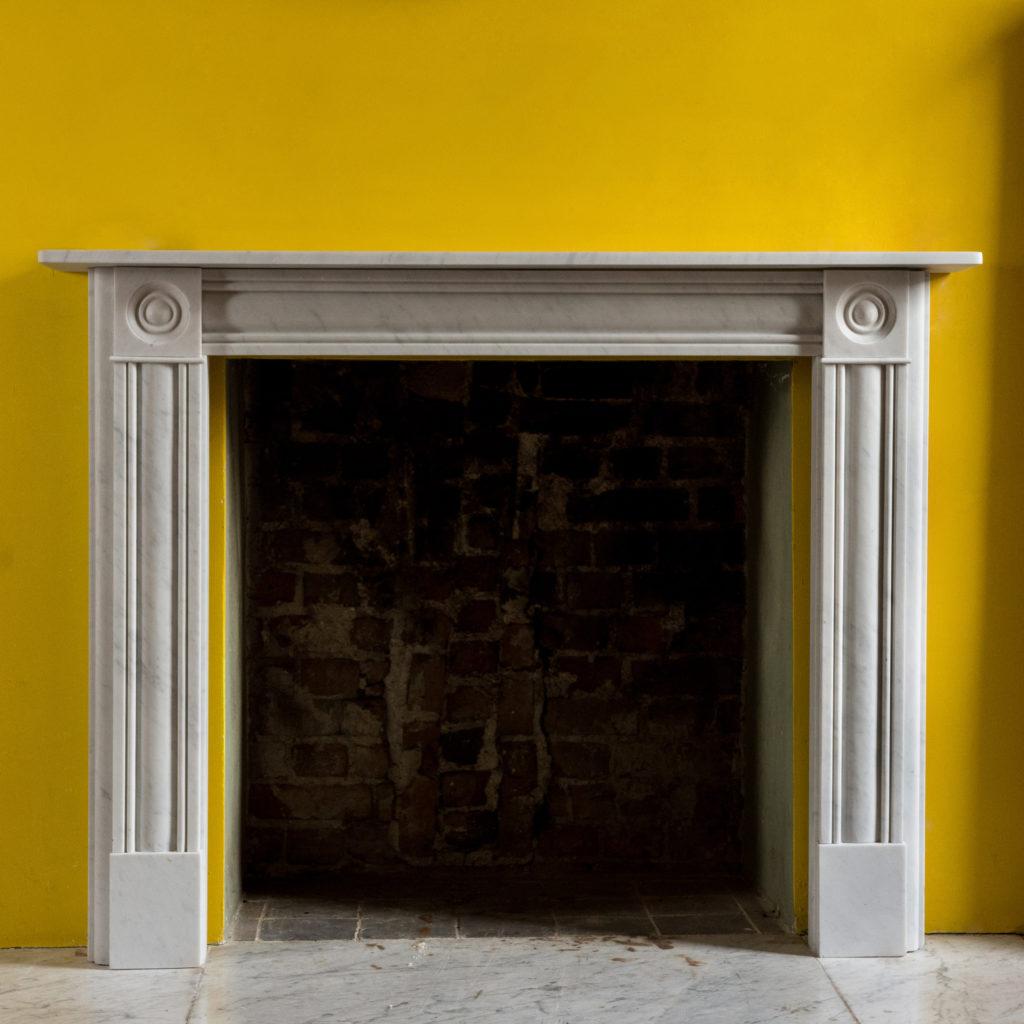 Regency style Carrara marble bullseye chimneypiece-99825