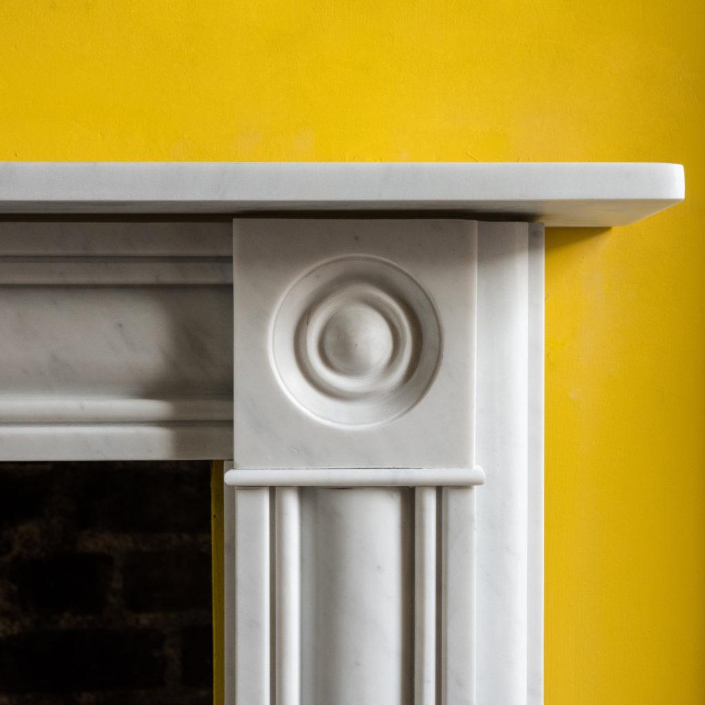 Regency style Carrara marble bullseye chimneypiece-99827