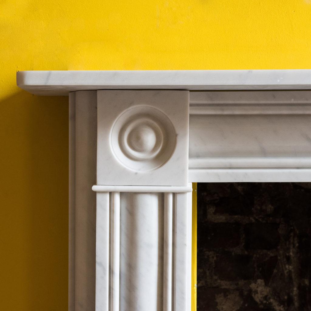 Regency style Carrara marble bullseye chimneypiece-99823