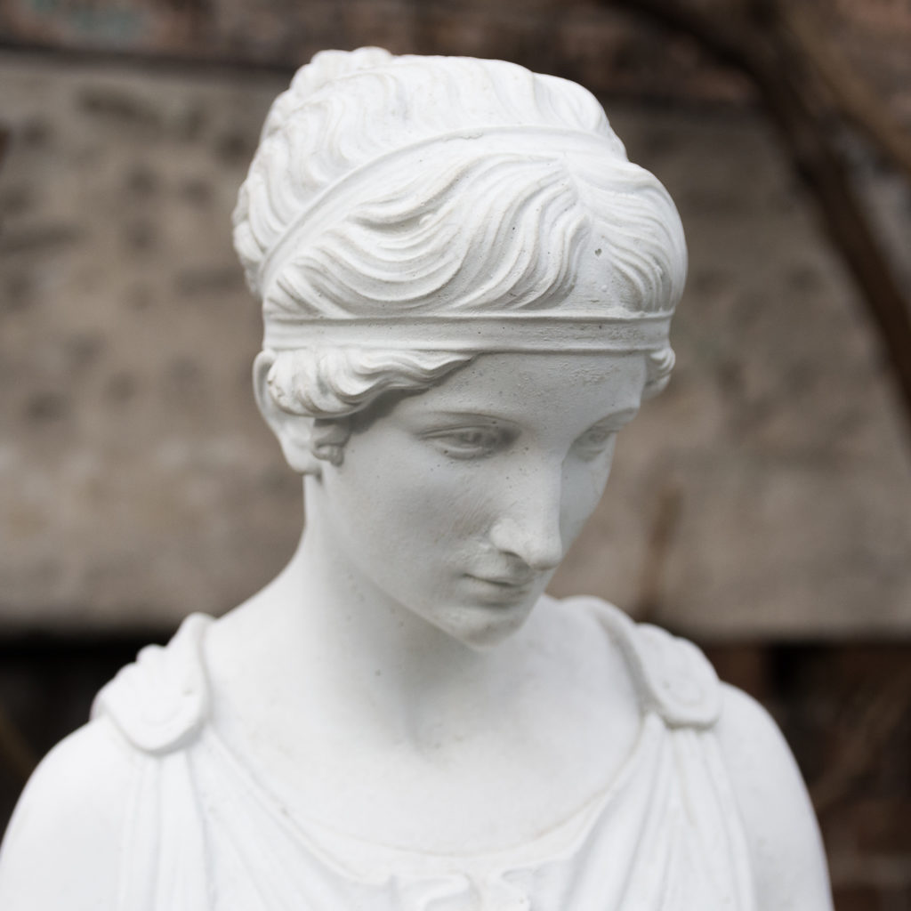 Small Italian reconstituted marble figure of Hebe,-112450