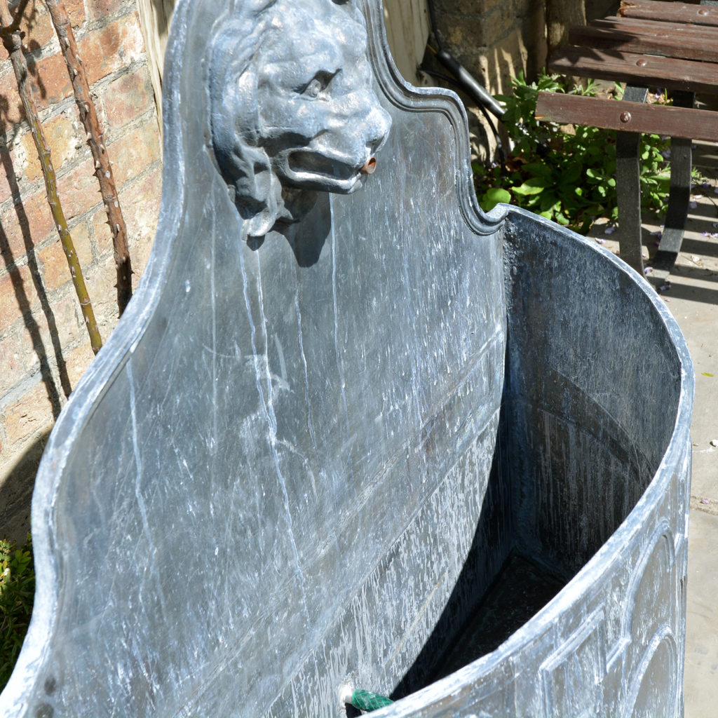 An English lead cistern with lion mask spout-88501