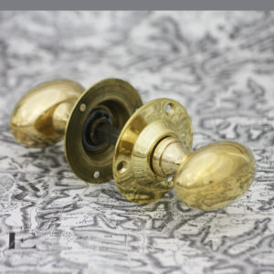 Oval brass door knob