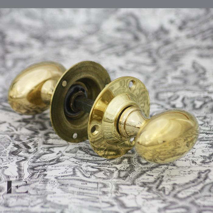 Oval brass door knob