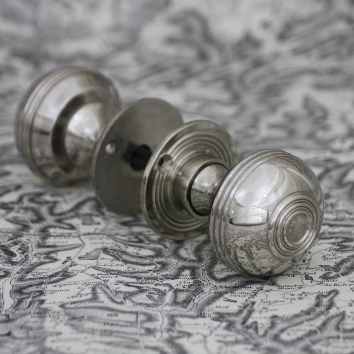 Reeded nickel plated door knobs