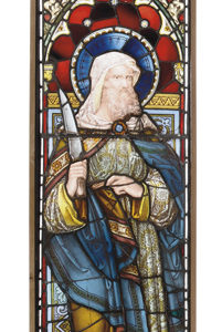 A stained and painted glass window panel depicting St. Bartholomew-0