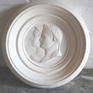An English relief cast plaster double-portrait roundel of Napoleon and Josephine-0