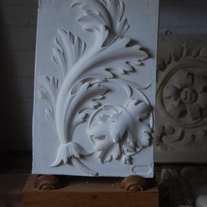 A cast plaster relief depicting a spray of acanthus leaves-0