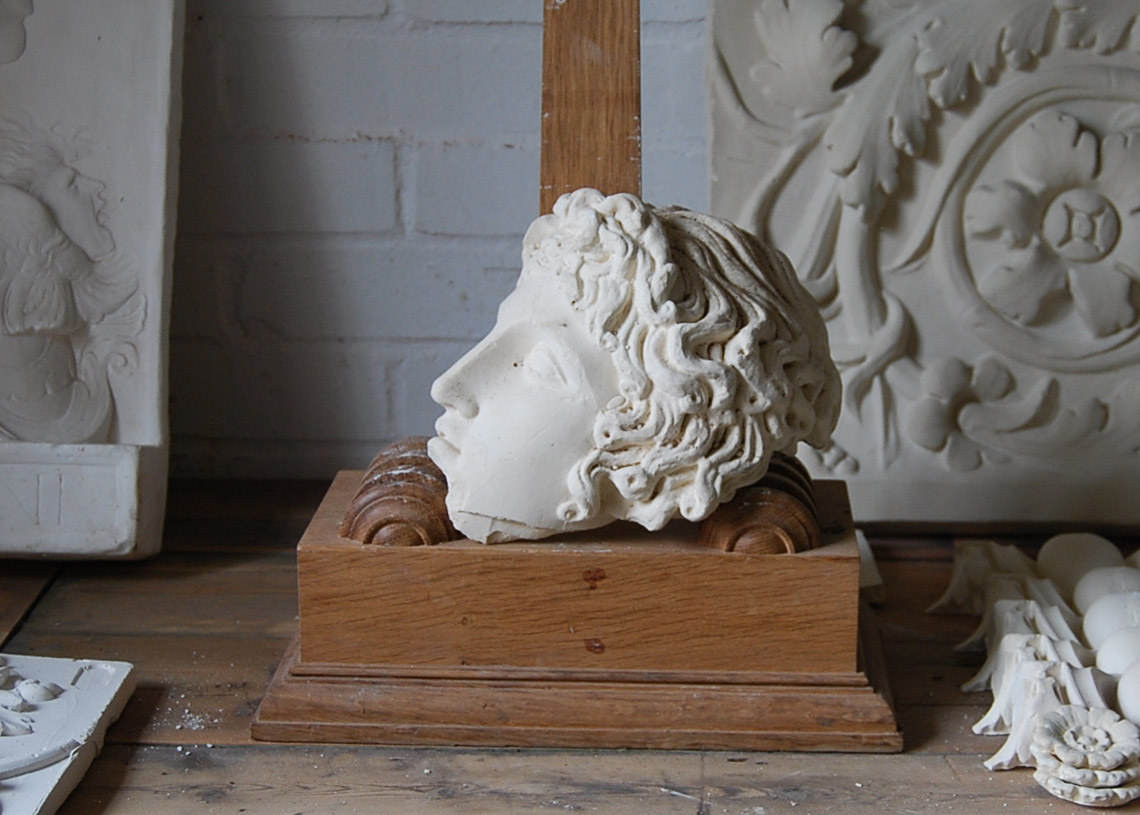 A cast plaster fragment of a classical head-0
