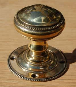 A pair of brass 'Beaded' door knobs-0