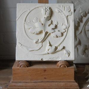 A cast plaster section of foliate frieze-0