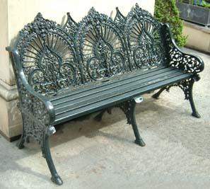 A cast iron three seater garden bench-0