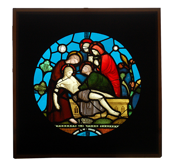 A stained and painted glass window depicting the lamentation of Christ-0