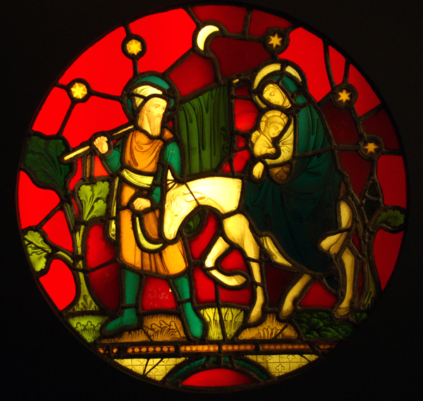 A stained and painted glass window panel depicting the flight to Egypt-0
