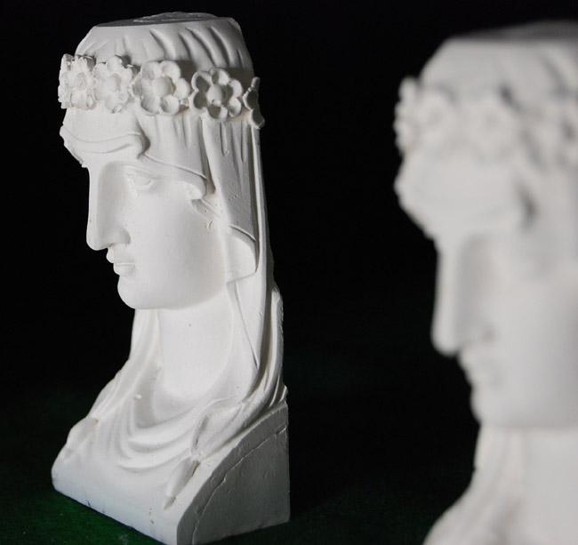 An English cast plaster model of a female Grecian head-0