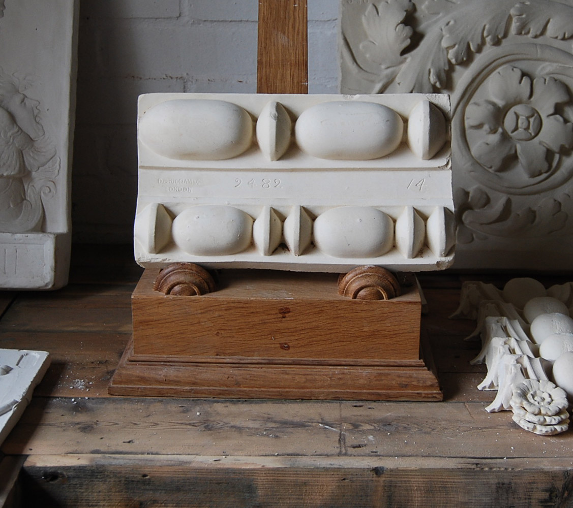 A cast plaster relief of 'reed and bead' mouldings-0