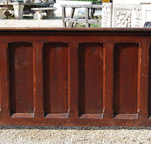 A Victorian pine pew front with carved termini-0