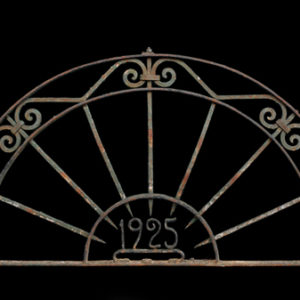 A wrought iron demi-lune over door-0