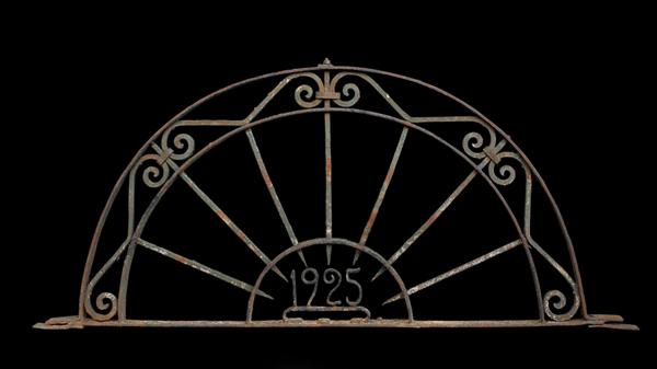 A wrought iron demi-lune over door-0