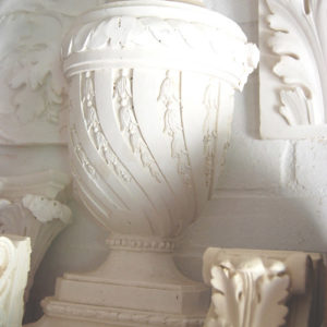 An English relief cast plaster lidded half-urn-0