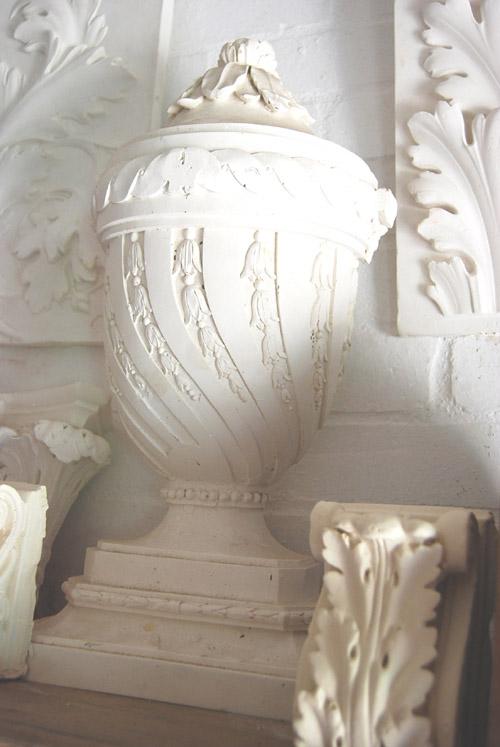 An English relief cast plaster lidded half-urn-0