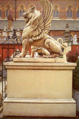 A large rectangular composition stone pedestal made en suite to the massive winged lion-0