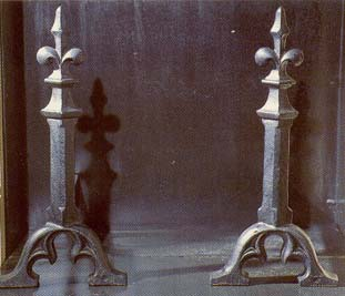A pair of cast iron andirons,-0