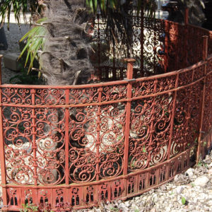 An ornate demi-lune Victorian wrought iron railing-0