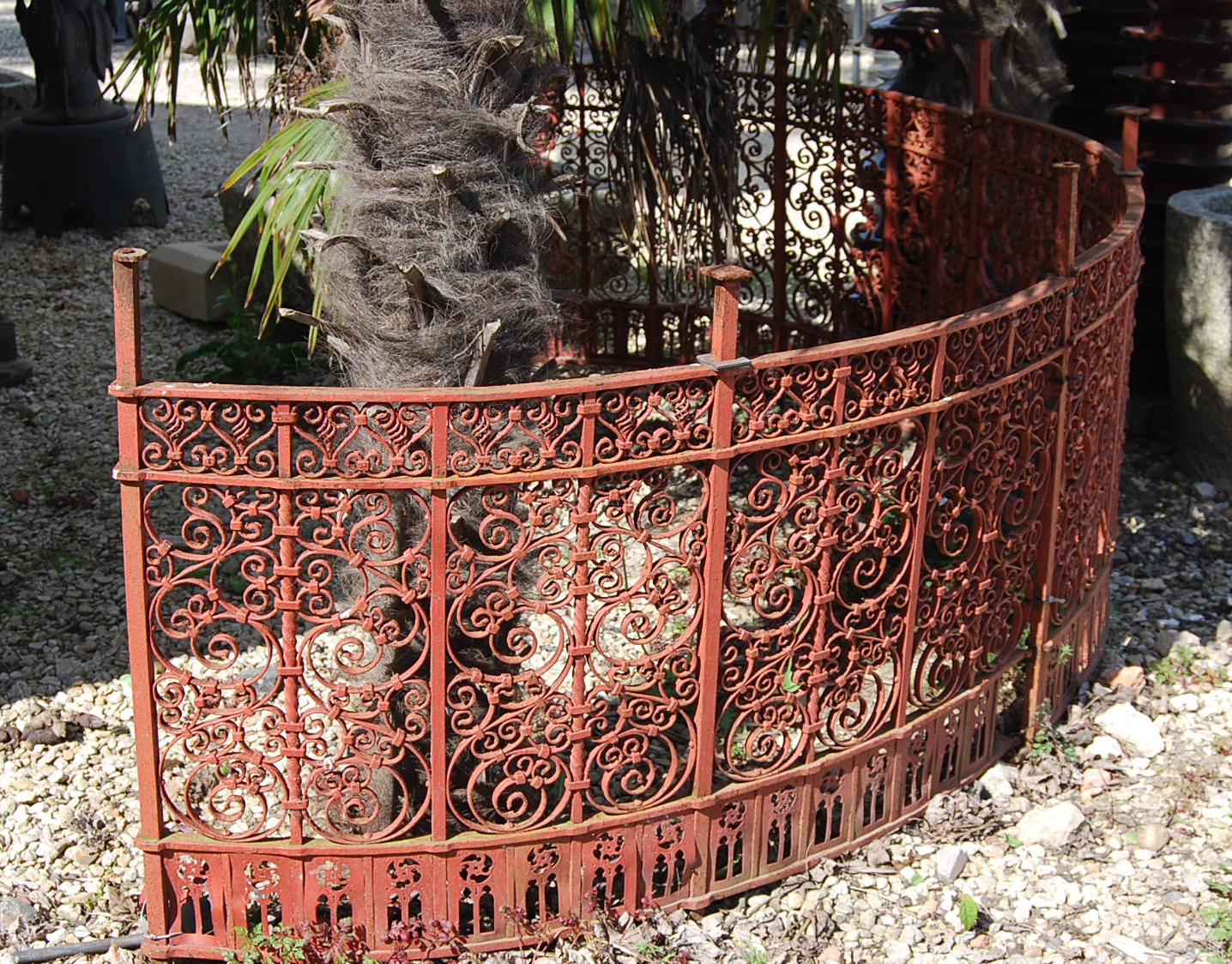 An ornate demi-lune Victorian wrought iron railing-0