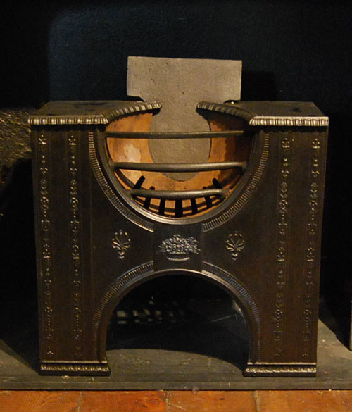 A late George III cast iron hob grate-0