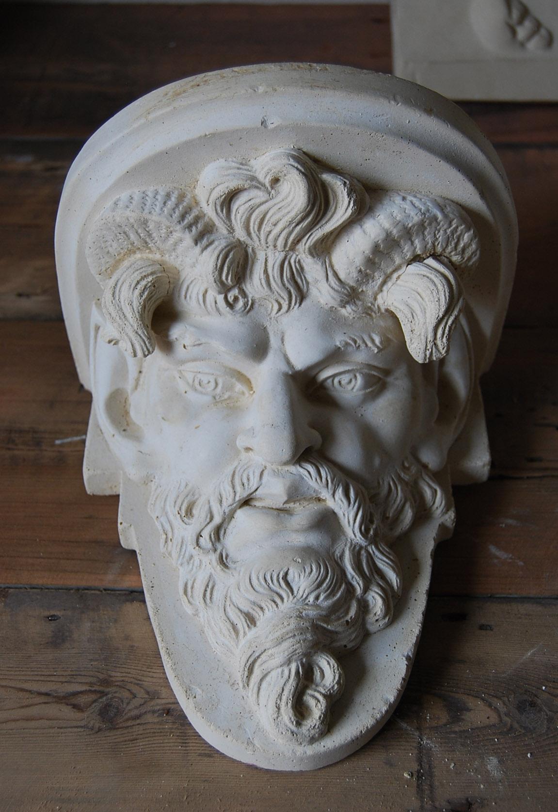 A cast plaster Satyr mask bracket-0