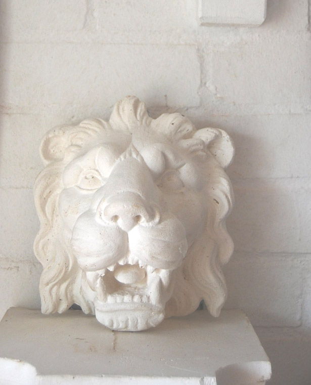 An English relief cast plaster head of a lion-0