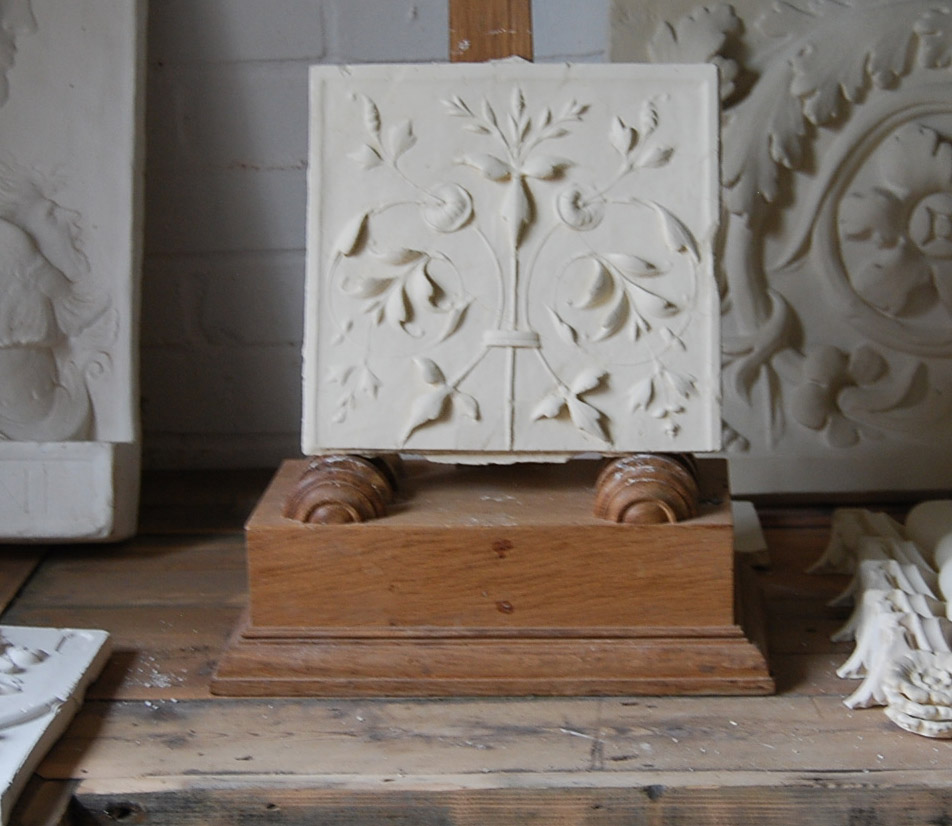 A cast plaster section of delicate ornamental relief-0