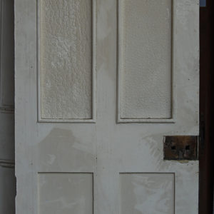 A Victorian four panel part glazed pine door-0