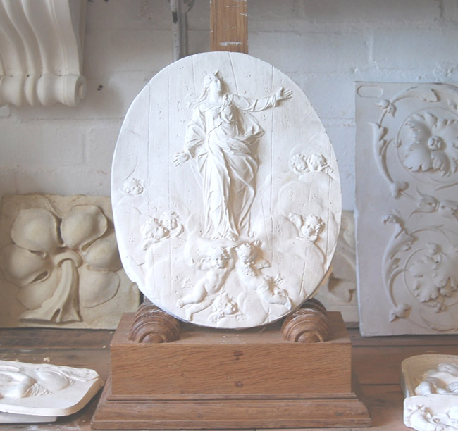 An English relief cast plaster plaque of the Madonna-0