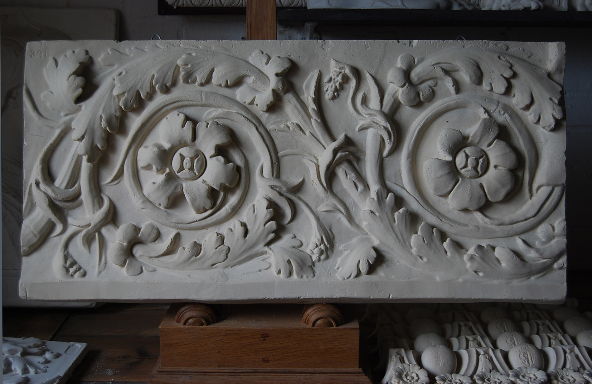A cast plaster section of foliate scroll frieze-0