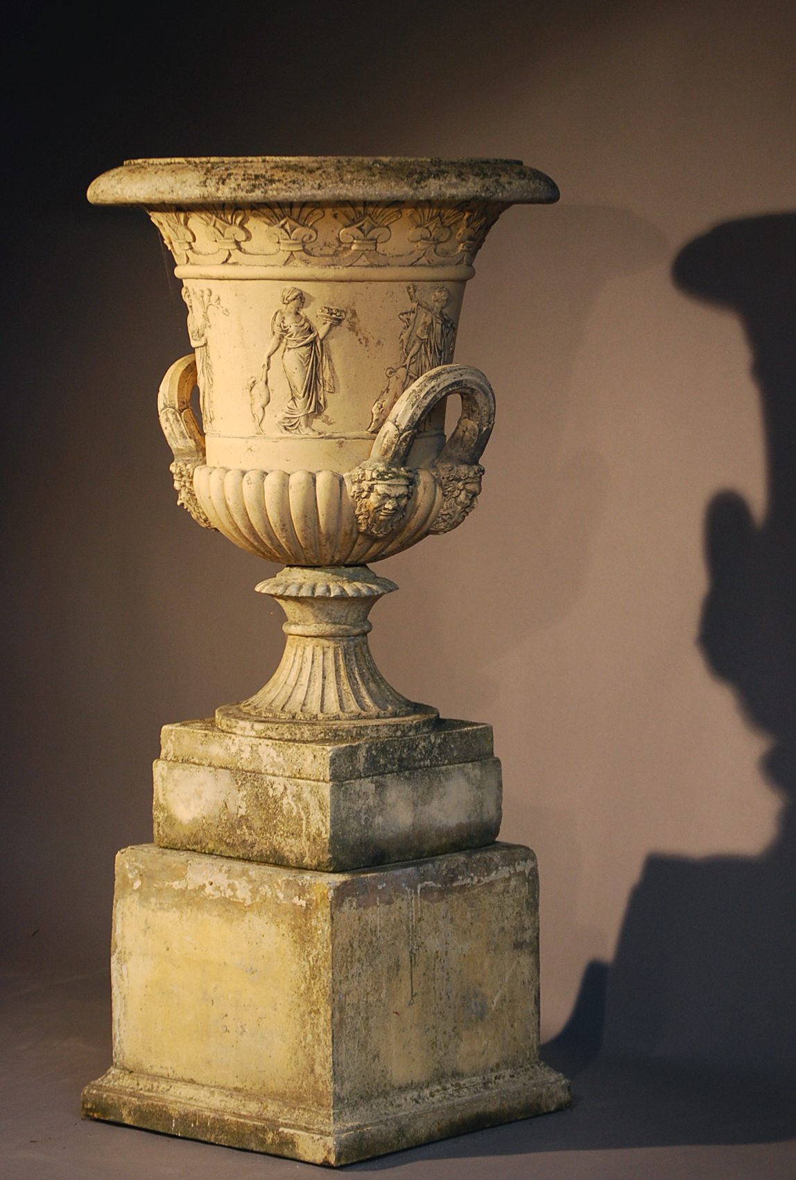 An English reconstituted stone semi-lobed Campana urn-0