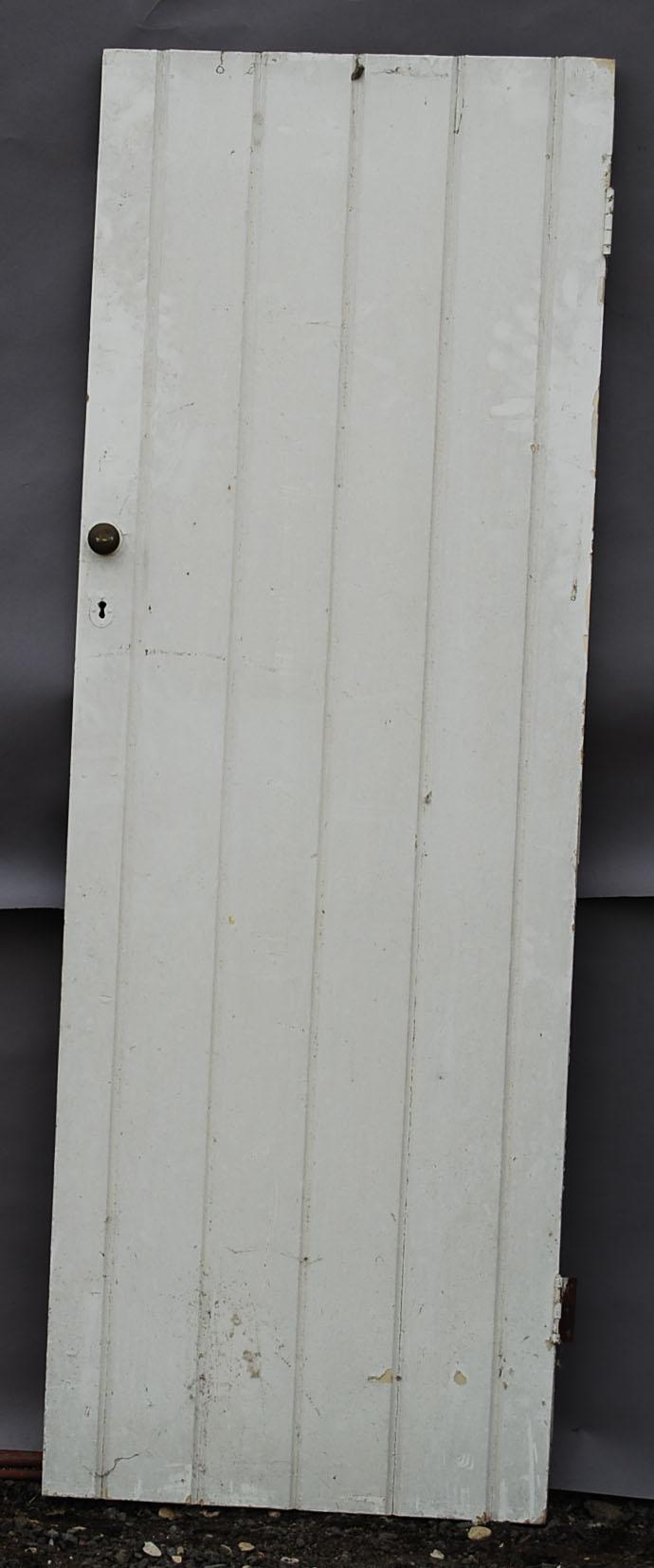 An Edwardian plank pine cupboard door-0