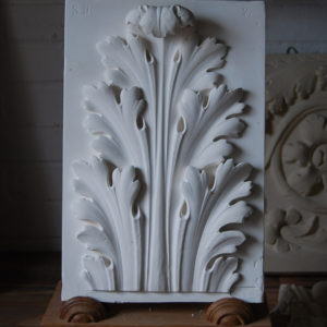 A cast plaster acanthus leaf relief-0