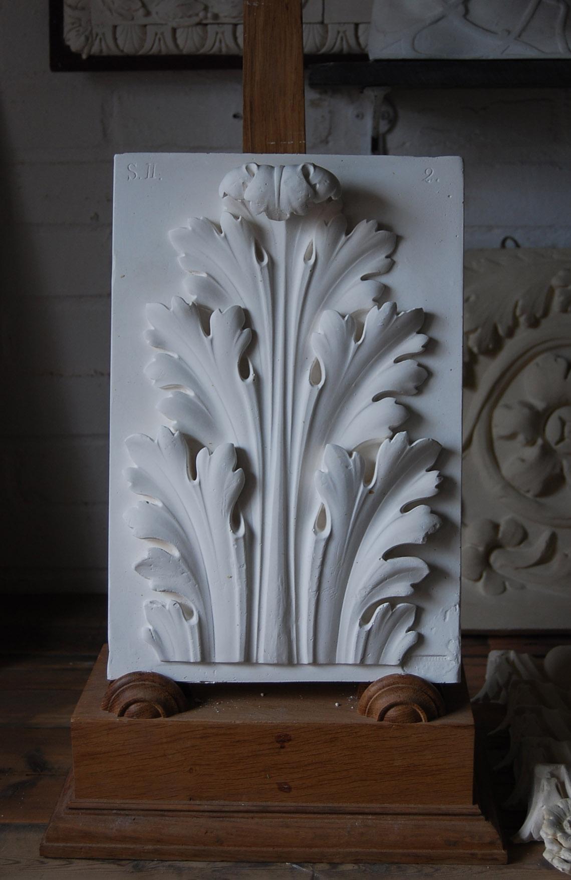 A cast plaster acanthus leaf relief-0