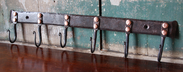 A medium hand forged iron and copper hook plate,-0