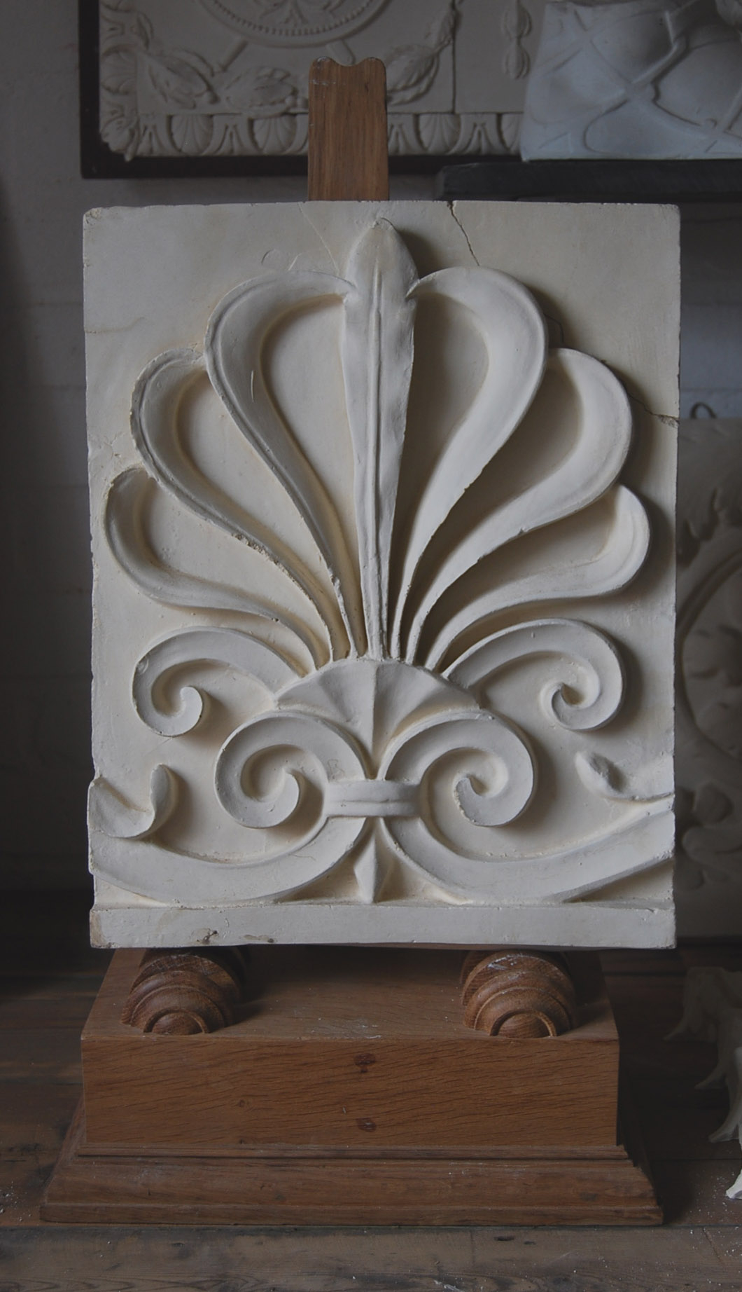 A plaster cast of an anthemion in relief-0