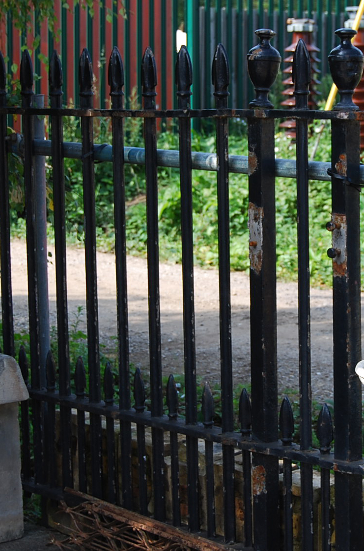 A long run of heavy guage Victorian cast iron railing-65630
