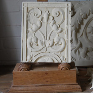 A cast plaster section of frieze-0