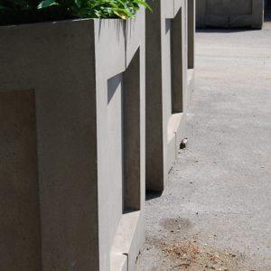 A series of massive, concrete, Brutalist treeplanters-0